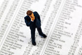 Business man figure on share prices — Stock Photo