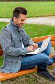 Man with laptop in the park — Stock Photo