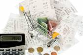 Shopping cart, receipts and money — Stock Photo