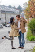 Lovers stroll around the town — Stock Photo