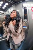 Woman with claustrophobia in elevator — Stock Photo