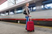 Woman waiting for train on railway station — Stock Photo