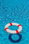 Lifebuoy in a swimming pool — Stock Photo