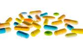 Tabletki na jasnym tle — Zdjęcie stockowe