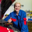 Woman as a mechanic in auto repair shop — Stock Photo #59181085