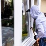 Burglar at a window — Stock Photo #59183083