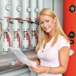 Woman in the boiler room for heating. — Stock Photo #59183689