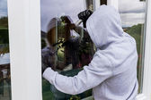 Burglar at a window — Stock Photo