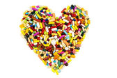 Colorful pills in heart shape — Stock Photo