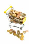 Shopping basket with coins — Stock Photo