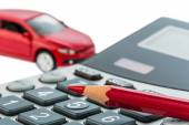 Auto, red pen and calculator — Stock Photo