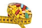 Tabletten und Maßband — Stockfoto
