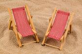 Deck chair on the sandy beach — Stock Photo