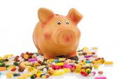 Tablets and piggy bank — Stock Photo