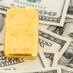 Gold bars on dollar bills — Stock Photo #61470619