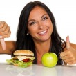 Choosing between hamburger and apple — Stock Photo #61470665