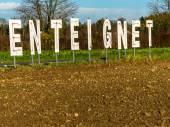 Expropriates lettering on a field — Stok fotoğraf