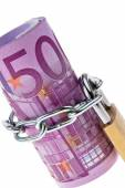 Euro bank note closed with a chain — Stock Photo