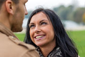 Courting couple in a park — Stock Photo