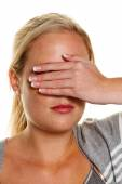 Woman holding her eyes to — Stock Photo