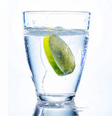 Water glass and lime — Stock Photo
