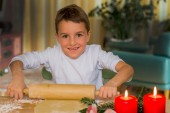 Child baking cookies for christmas — Stock Photo