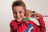 Child with a tin can phone — Stock Photo