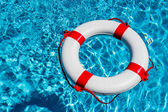 Lifebuoy in a pool — Stock Photo