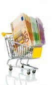 Bills in a shopping cart — Stock Photo