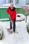Man shoveling snow at — Stock Photo