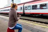 Woman waiting for train and writes sms — Stock Photo