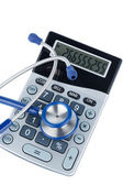 Stethoscope and calculator — Stock Photo