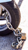 Motorcycle secured with padlock — Stock Photo