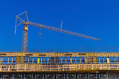 Construction site with crane — Stockfoto