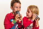 Children with a tin can phone — Stock Photo