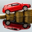 Rising car costs. car on coins — Stock Photo #61503575
