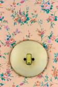 Old wallpaper with light switch — Stock Photo