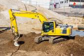 Excavator on construction site during earthworks — Stock Photo
