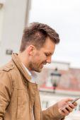 Man writing sms — Stock Photo