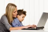 Mother and son on computer — Stok fotoğraf