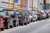 Cars parked on the roadside — Stock Photo