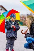 Mother and child with umbrella — Stock Photo