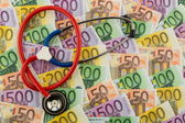 Stethoscope and euro banknotes — Stock Photo