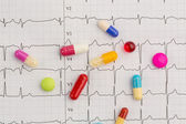 Tablets on an ecg — Stock Photo