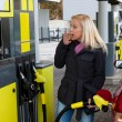 Woman at the gas station to refuel — Stockfoto #63194847