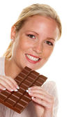 Woman with a bar of chocolate — Stock Photo