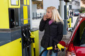 Woman at the gas station to refuel — Stock Photo