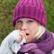 Woman has a cold and is cold — Stock Photo #63656707