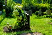 Grave stone at cemetery — Stock Photo