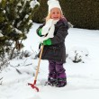 Snow shoveling snow shovel in the winter — Stock Photo #65833173